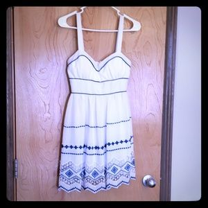 White sundress with blue embroidery